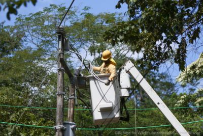 electrical worker in bucket truck insulating a tranformer in Costa Rica